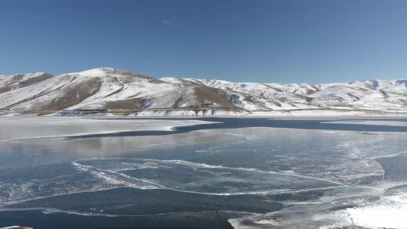 Thumbnail for Frozen Water Surface of Lake Floe Melts in Spring