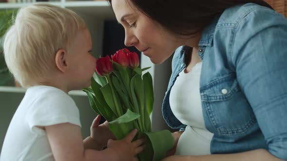 Thumbnail for Handheld video of toddler giving flowers to his mother. Shot with RED helium camera in 8K