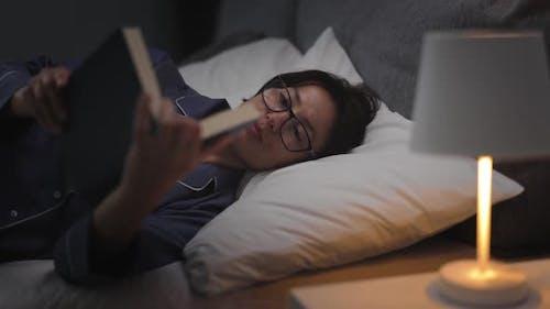 Woman Reading Before Sleep