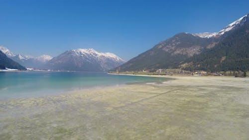 Low Water Level in Lake for Energy Saving During Off-Season at Alpine Ski Resort