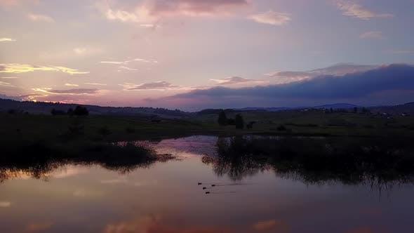 Thumbnail for Aerial footage, sunset, mountain lake