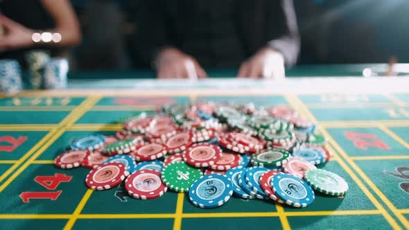 Risky Man Betting All Chips in While Playing in Casino and Takes a Winning Bet in a Casino