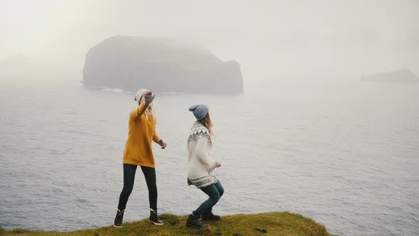 Thumbnail for Two Happy Woman Dancing on the Shore of the Sea in Iceland, Cheerful Tourists Exploring