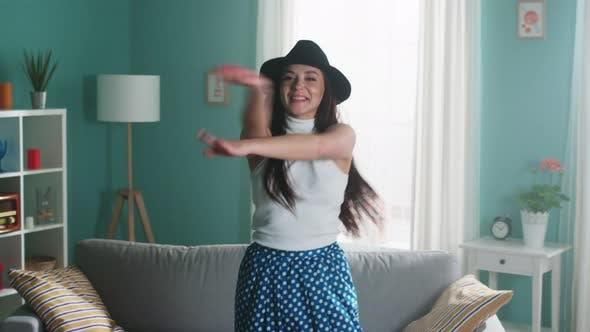 Woman In Black Hat Is Dancing Lovely