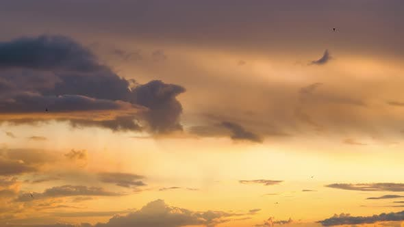 Cover Image for Stormy Clouds Move Smoothly in the Red Sky at Sunset. Timelapse. Cloud Space.