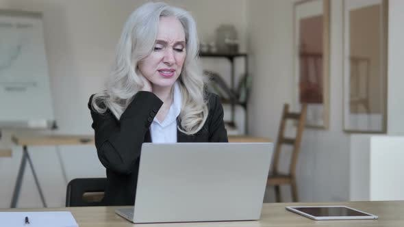 Cover Image for Tired Old Businesswoman with Neck Pain at Work