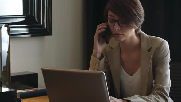 Thumbnail for Businesswoman Working at Desk in Hotel Room