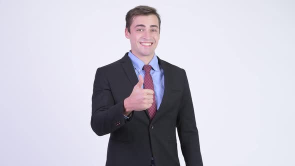 Thumbnail for Young Happy Handsome Businessman Giving Thumbs Up