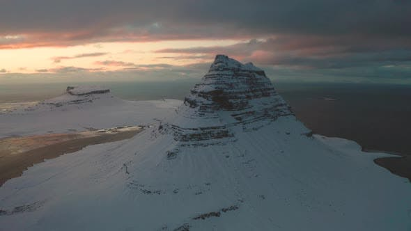 Thumbnail for Bird's-eye View of the Snowy Mount Kirkjufetl. Iceland, Winter