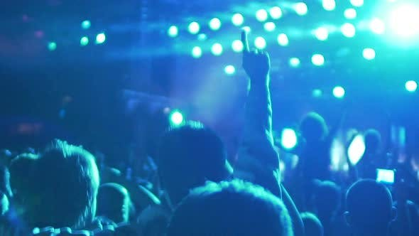 Thumbnail for Slow-Mo of Excited Crowd Enjoying Cool Concert, Friends Hugging and Jumping