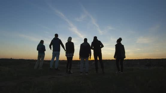 Cover Image for Friends Walking Together Into the Setting Sun