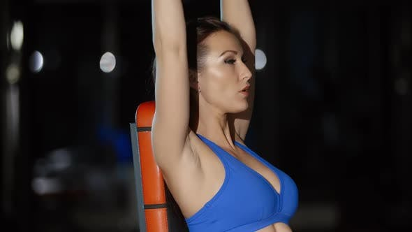 Thumbnail for Attractive Woman Athlete Training Hands Exercising With Dumbbells Press Workout in Gym