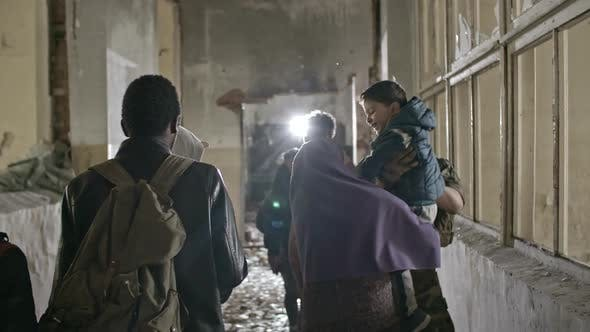 Thumbnail for Arab Refugees Walking in Destroyed Building