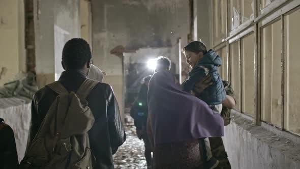 Arab Refugees Walking in Destroyed Building
