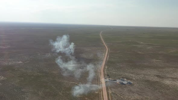 Thumbnail for Plains And Road With Smoke Aerial View