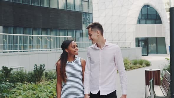 Mixedrace Family Spending Time Together Outdoors in a City with Modern Architecture