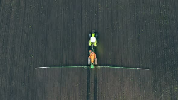 Thumbnail for Aerial View on Top. Farm Machinery Spraying Insecticide To the Green Field, Agricultural Natural