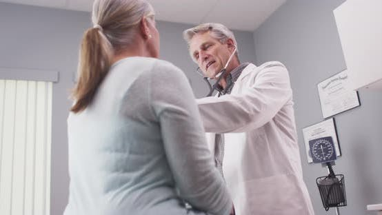 Thumbnail for Doctor examining patient with stethoscope