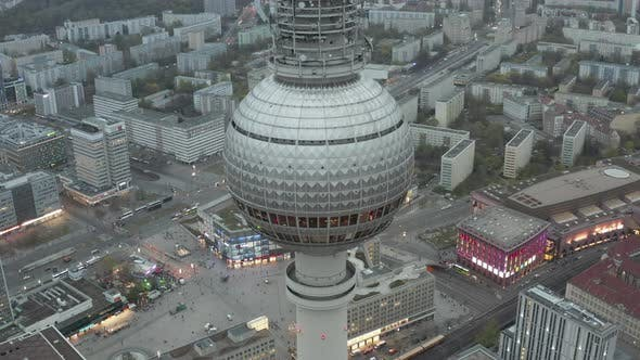 AERIAL: Close Up of Berlin Germany TV Tower Alexanderplatz at Daylight with Cloudy Weather