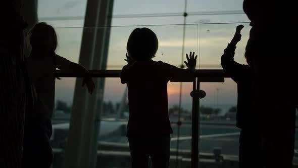 Children Standing Near the Window at the Airport