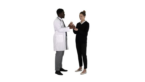Thumbnail for Male doctor offers medication to young woman on white background.