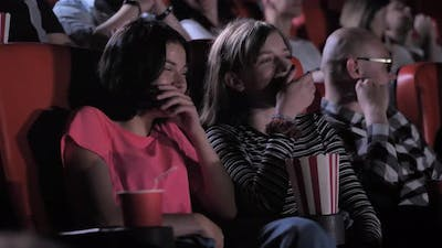 Teenage Girls Shaking with Laughter During Comedy