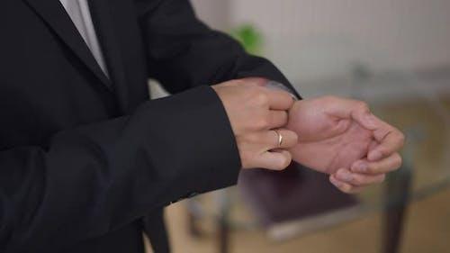 Closeup Male Hands Adjusting Blazer Sleeve