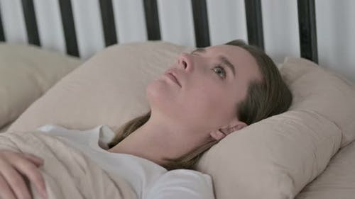 Young Woman with Insomnia Lying in Bed at Home