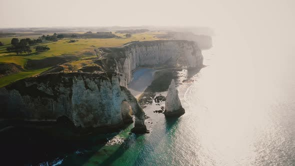 Thumbnail for Amazing Drone Panorama of Epic Natural Rocky Arches and Pillars at Famous White Chalk Seaside Cliffs