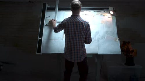 Young Engineer Standing At The White Board