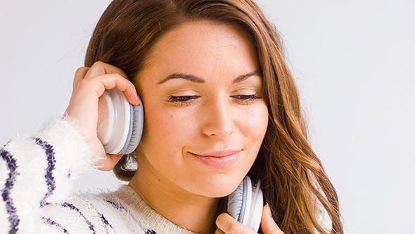 Thumbnail for Smiling Girl Listen Music in Her Headphones