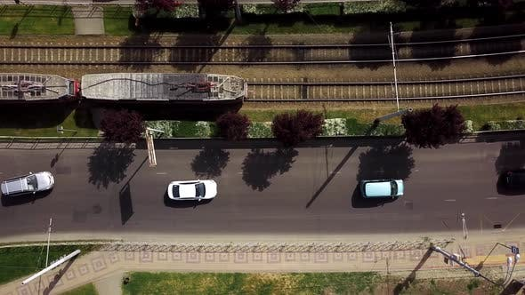 Thumbnail for Top Down Street View of Freeway Busy City Rush Hour Heavy Traffic Jam Highway and Tram Way.