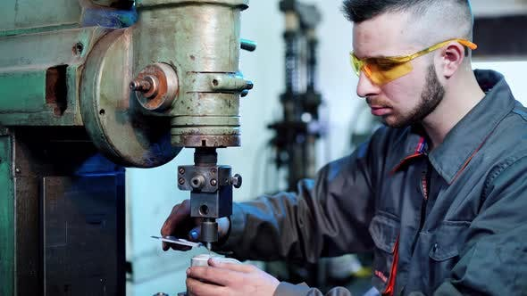 Factory worker at industrial facilities. Industrial machine operator working in factory