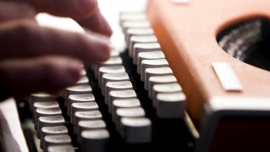 Thumbnail for Close Up Shot of Man Typing on Old Vintage Retro Typewriter. News, Media Concept