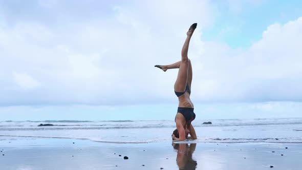 Thumbnail for Flexible Yoga Woman Stretching Forward Bend Touching Forehead To Knees Outdoors Sunset Sea Beach