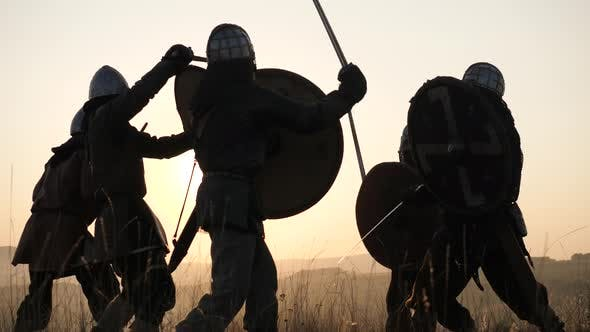 Medieval warriors fighting at sunset