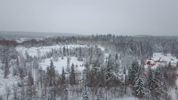 Thumbnail for Aerial View of Village in Snowy Forest