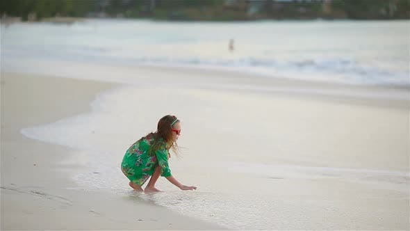 Thumbnail for Adorable Little Girl Have Fun at Tropical Beach During Vacation