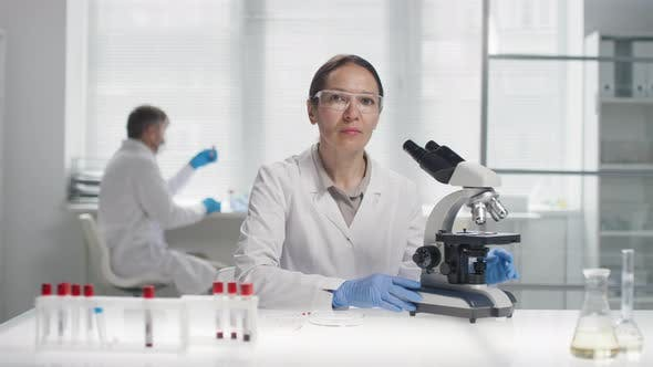 Thumbnail for Female Biomedical Scientist Posing for Camera in Lab