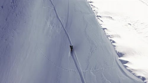 Snowboarder Solo Steep Run