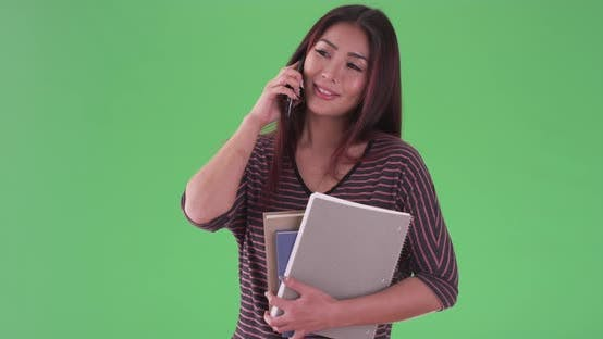 Thumbnail for asian woman talking on smartphone on green screen