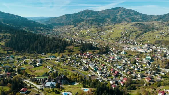 Thumbnail for Aerial Drone Shot Over the Village Mountain Landscape