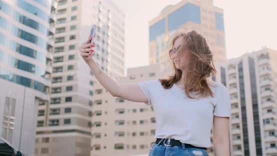 Thumbnail for Young Beautiful Girl Blogger Taking a Selfie on Smartphone