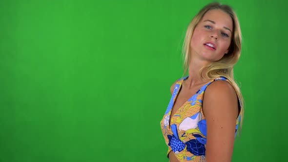 Thumbnail for Young Pretty Blond Woman Does Poses To Camera - Green Screen - Studio