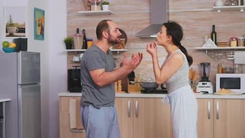 Violent Husband Shaking Wife