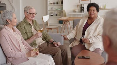 Senior People Drinking Wine with Friend