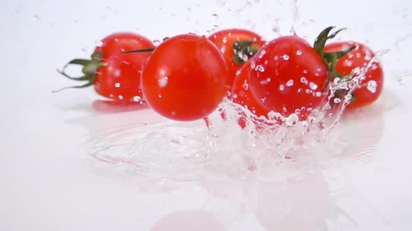 Thumbnail for A Several Ripe Tomatoes are Falling on the Table