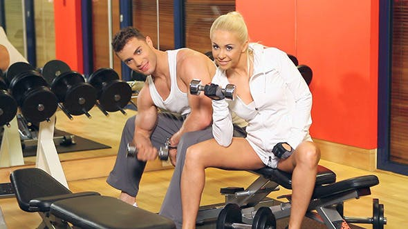 Thumbnail for Sporty Couple Doing Exercises at The Gym