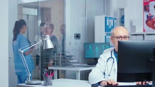Thumbnail for Doctor Working in Busy Clinic
