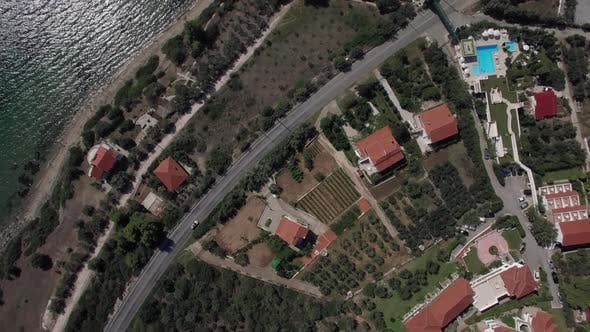 Flying Over the Cottages on Seafront of Trikorfo Beach, Greece